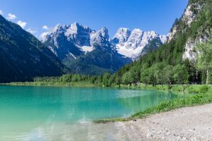 Majestic mountains were rising behind the emerald coloured Lago di Landro.
