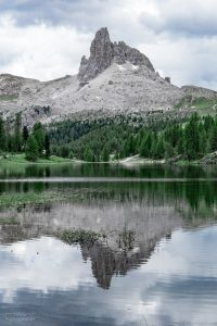 The smooth surface of Lago di Federa beatifully reflected a lonely peak in the distance.